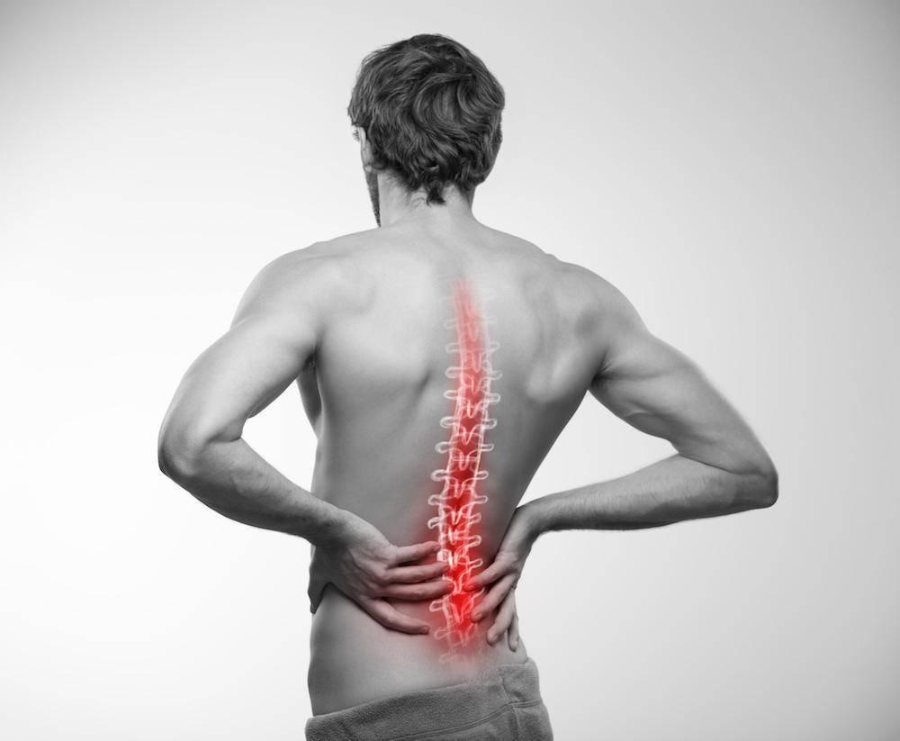 Почему болит спина